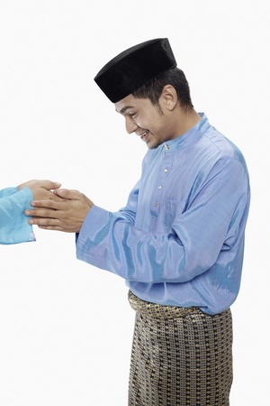 blessing: Man in traditional clothing greeting another person