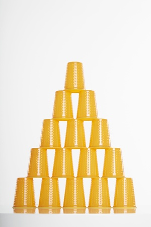 Pyramid of yellow disposable cups Stock Photo - 19284969