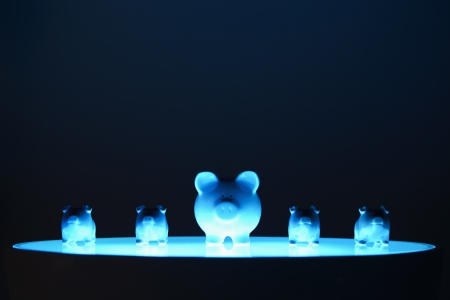 Piggy banks lined up in a row Stock Photo - 19284978