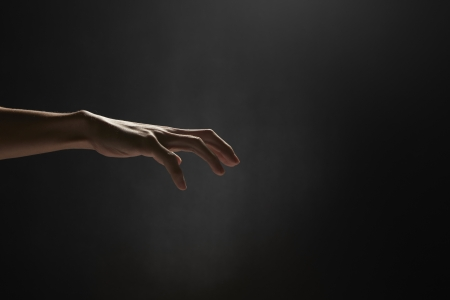 grasping: Human hand showing grasping gesture