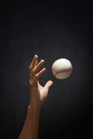 tossing: Human hand tossing a baseball