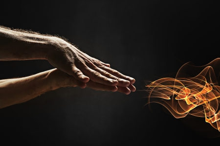 side effect: Human hand producing fire Stock Photo