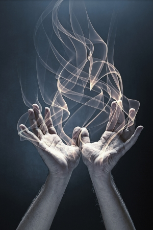 burning man: Human hands with fire coming out of it