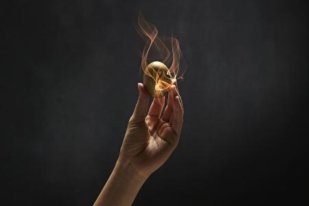 golden egg: Human hand holding a golden egg