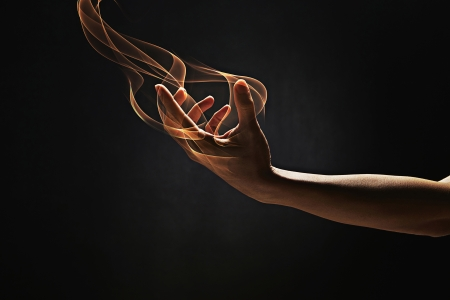 burning man: Human hand reaching out