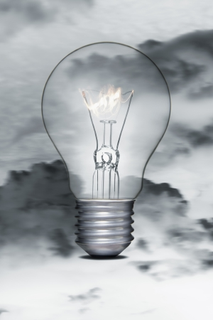 Burning flame in a light bulb photo