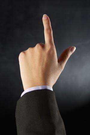 dedo indice: Dedo �ndice apuntando hacia delante Foto de archivo