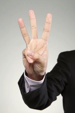 Three fingers held up photo