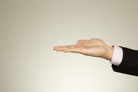 Person holding out his palm Stock Photo - 22831320