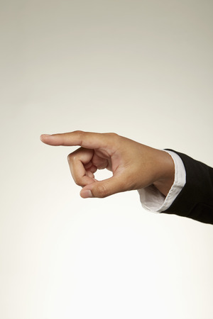 Person showing pointing gesture photo