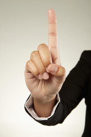 Index finger held up photo