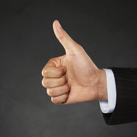 Person giving thumbs up photo