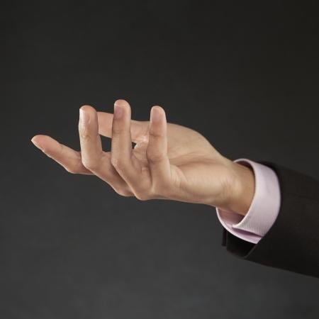 generoso: La mano del hombre llegar Foto de archivo