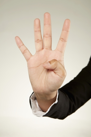 Four fingers held up photo
