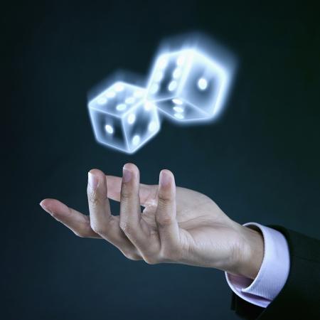 Human hands tossing dice