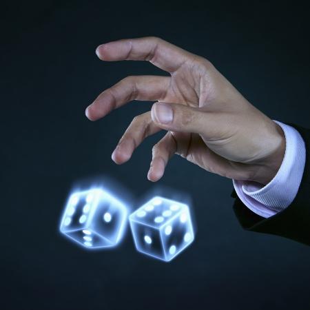 tossing: Human hands tossing dice
