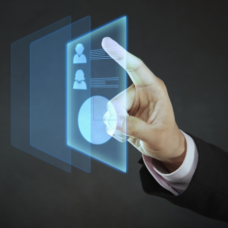 screen shot: Index finger pointing at digital information Stock Photo