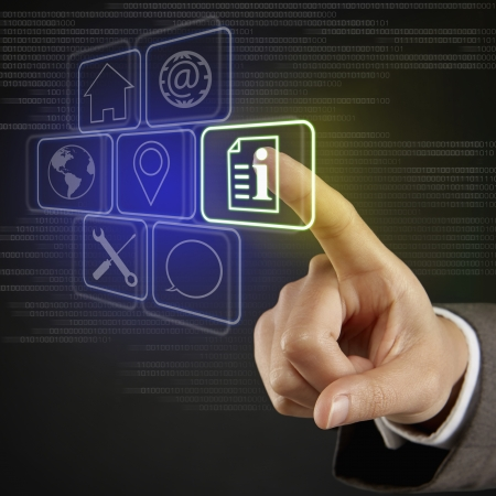 screen shot: Index finger pointing at digital tiles with different symbols Stock Photo