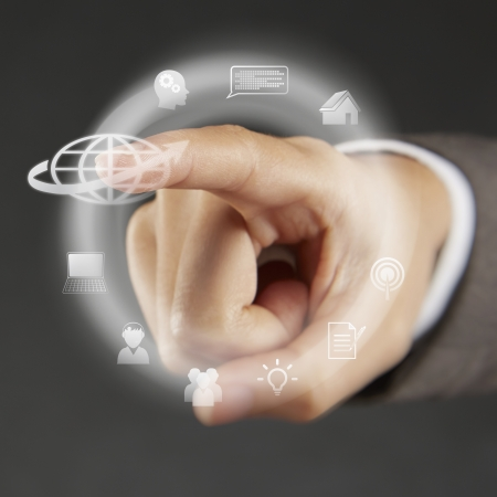 screen shot: Index finger pointing at symbols on a touch screen menu Stock Photo