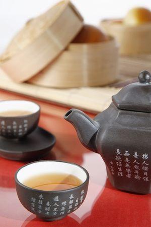 Chinese tea set with dim sum photo