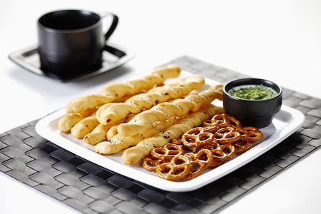 Plate of cheese sticks and mini pretzels with dip photo