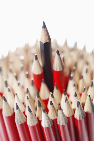 Blue pencil among bunch of red pencils Stock Photo - 6513484