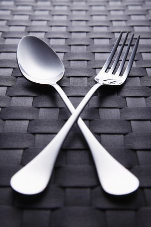 a place of life: Fork and spoon on place mat