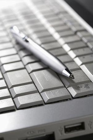 Pen on laptop photo