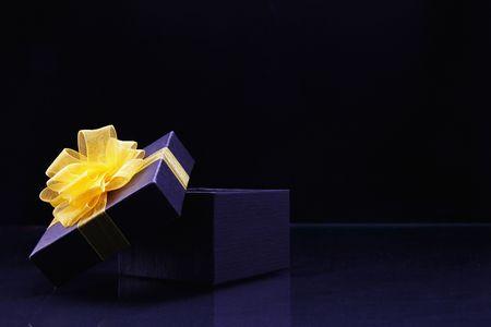 Purple gift box with yellow ribbon Stock Photo - 6513198