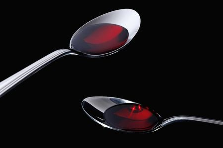 cough medicine: Two spoons with cough medicine
