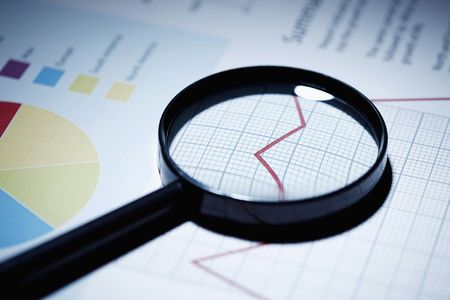 Magnifying glass on line graph