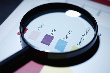 legends: Magnifying glass on graph legends Stock Photo