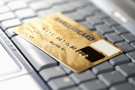 Credit card on laptop Stock Photo - 6513490