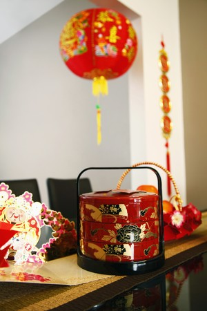 Chinese New Year decorations and cards on glass table photo