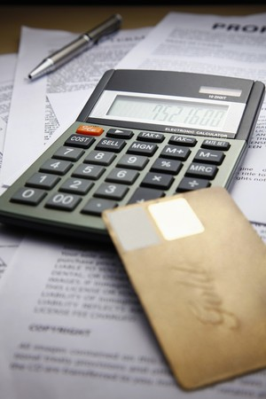 Calculator and credit card on documents photo