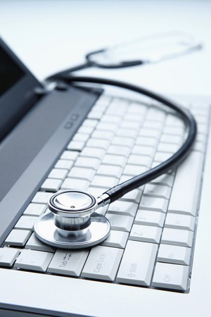 stethoscopes: Stethoscope on laptop
