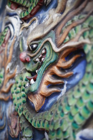 Sculpture of dragon on wall Stock Photo - 7003310