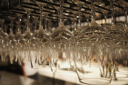 Rows of hanging wine glasses Stock Photo