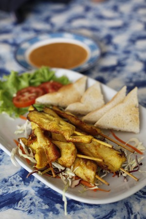 barbecued: Barbecued chicken satay