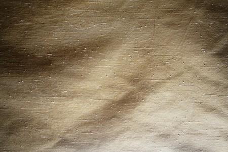 Close-up of worn cloth texture