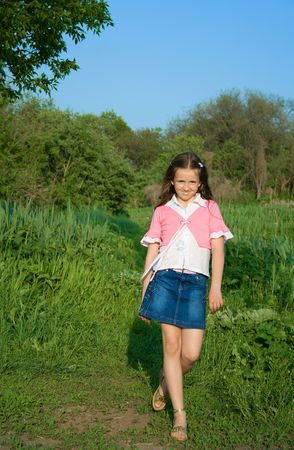 girl in the forest: happy girl on the edge of the wood Stock Photo