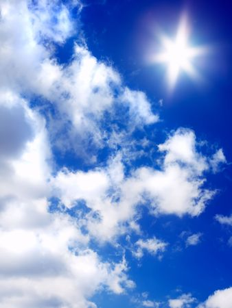sun and beautiful clouds on blue sky Stock Photo