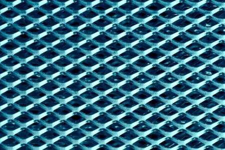 Texture of blue metal perforated sheet photo