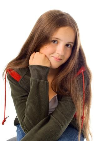 Portrait of stylish teenager girl. Isolated on white. photo