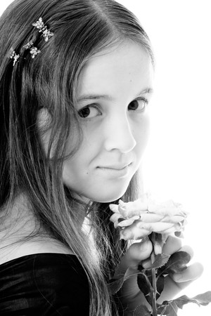 Portrait of teenager girl with long hair and rose flower photo