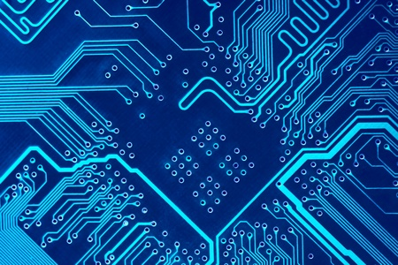 Abstract blue computer circuit board close up for background.