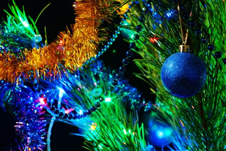 Christmas tree with decorations and lights at night photo