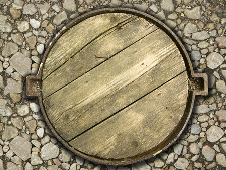 wooden lid: Cover of a manhole. Stock Photo