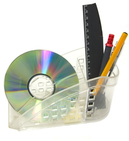 Close up of a CDROM, pen, ruler in plastic cup. Stock Photo - 1718547