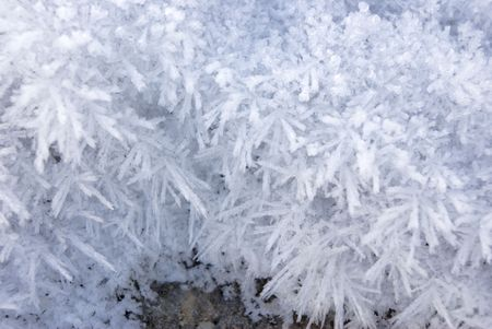 Greater crystals of an ice. Long needles under the bright sun